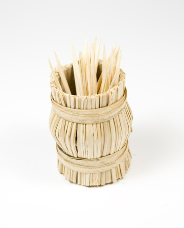 bast basket: Bast basket with wooden toothpick on white