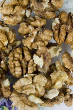 nutshell: group walnuts in brown pod without nutshell Stock Photo