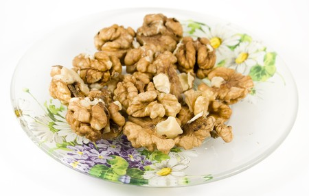 nutshell: group walnuts on saucer in brown pod without nutshell
