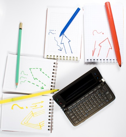 Open palmtop opposite four notebooks with felt-tip pens, crayon and wax pencil Stock Photo - 4239560