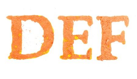def: Original alphabet, the crushed orange chalk, letters DEF Stock Photo