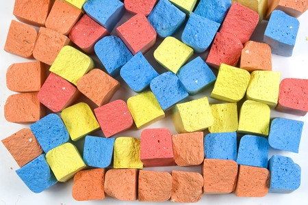 chalks: Set of mixed colored crushed childrens chalks in vertical