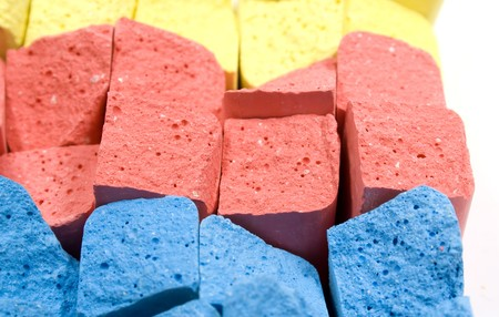 chalks: Stacked in rows group colored crushed chalks Stock Photo