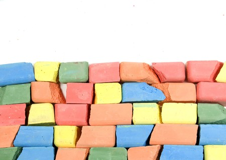 chalks: Set of mixed colored crushed childrens chalks, stacked in horizontal rows Stock Photo