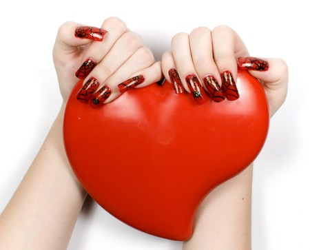 women's hands: Womens hands with heart and decorate manicure
