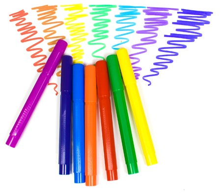 Color felt-tip pens on a background of the drawn rainbow Stock Photo - 4518104