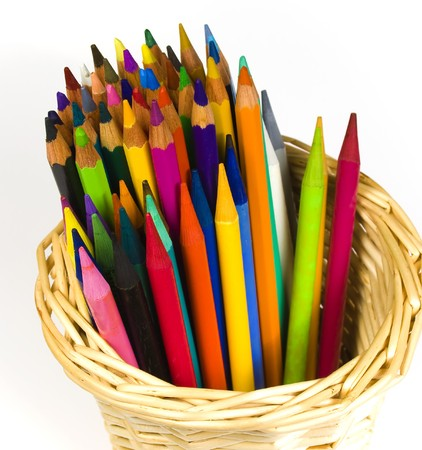 bast basket: Set of color wooden and woodless pencils in a bast basket