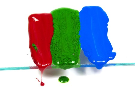 thawing: The wax of three primary colours thawing and dripping