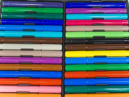 The color felt-tip pens laid in two of some on a black background photo