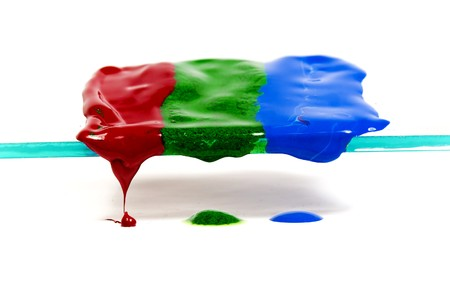 thawing: Three strips of thawing and dripping wax of red, dark blue and green colors
