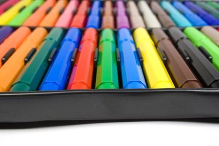 Color felt-tip pens close up in black photo