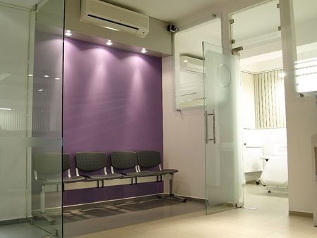 aseptic: private laboratory waiting room with purple walls Stock Photo