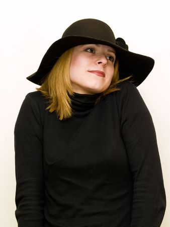woman dressed in black with hat on white background photo