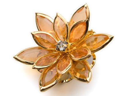 broach: isolated flower broach ambercoloured on white background