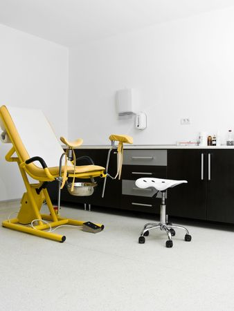 gynecology chair yellow in hospital room clinic