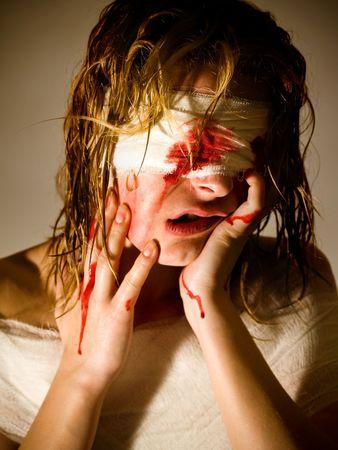 woe: hurt woman blind with bandage on eyes