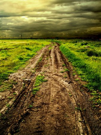 country road muddy whith tire tracks imprinted photo