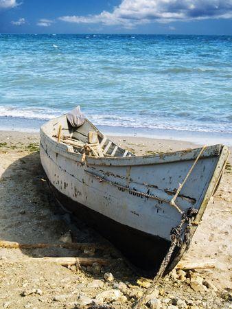 trammel: fisherman boat on sand at seacoast watter