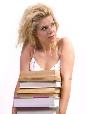 ponderous: blond woman carrying heavy books,  Stock Photo