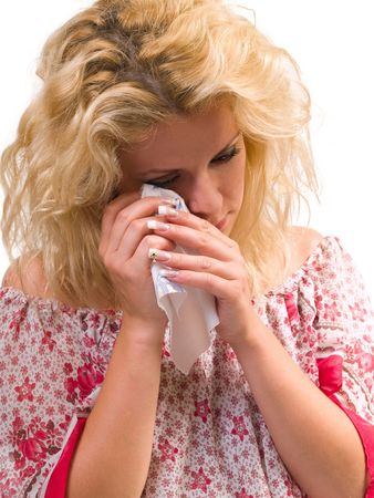sad blond woman wiping her tears with a napkin  Stock Photo