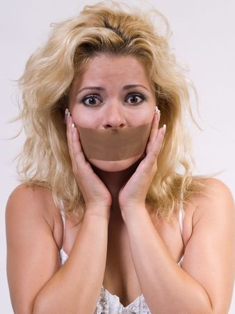 frightened  woman with tape on her mouth