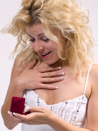 blond woman receiving a proposal ring photo