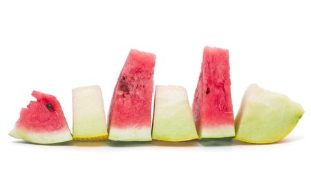 melon slices isolated on white background photo