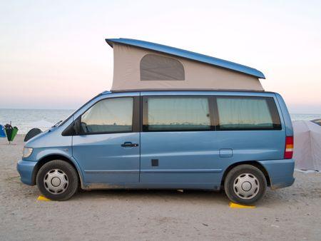 caravan car on the beach sunset Stock Photo