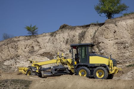 digging equipment excataving on a site for dirt