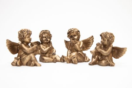 four small bronze angels islated on white background