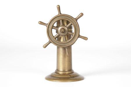 miniature nautical steering wheel isolated on white background