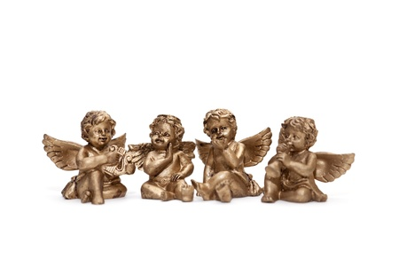 four small bronze angels isolated on white background