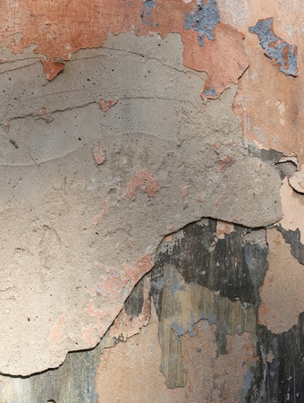 cracked cement: colorful old plaster wall, robbing