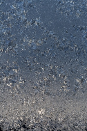 abstraction caused by winter frosts on glass photo