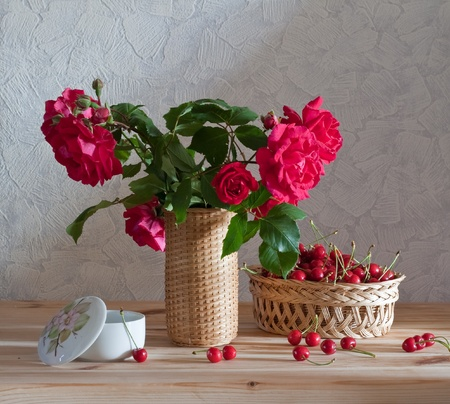 still life with roses and cherries photo