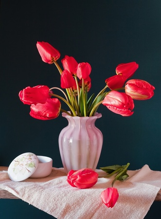 red tulips in a vase Stock Photo - 8602552