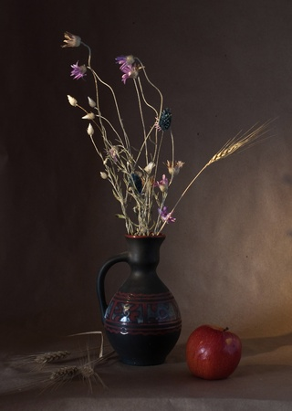 vase with ears of wheat and apple photo
