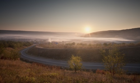 curvature of a road that goes in the fog Stock Photo