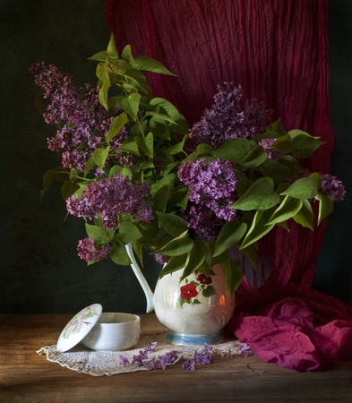 bouquet of spring purple Lilac in a vase. Still life photo