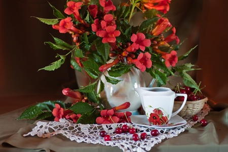 still life with flowers and cherry photo