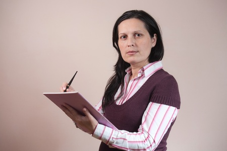 business woman making notes in journal photo