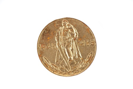 outworn: The coin - one ruble shows 20 years of victory over Nazi Germany, on a white background, circa 1965.