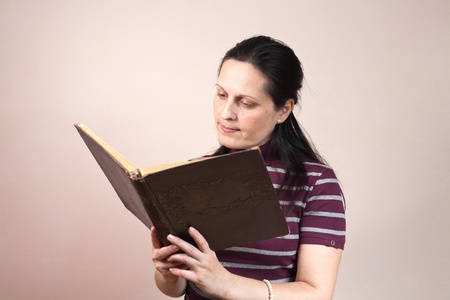 Lady reading a book carefully photo