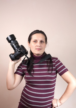 Portrait of a beautiful young woman with camera photo