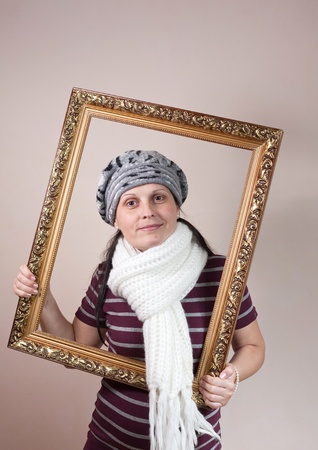 beautiful woman framed in a antique frame photo