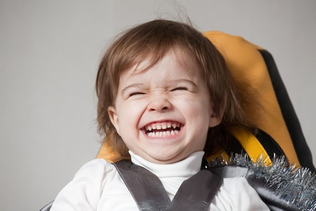 Portrait of a sweet baby girl, laughing  photo