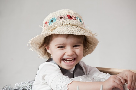 portrait of a little girl in hat on a white background photo