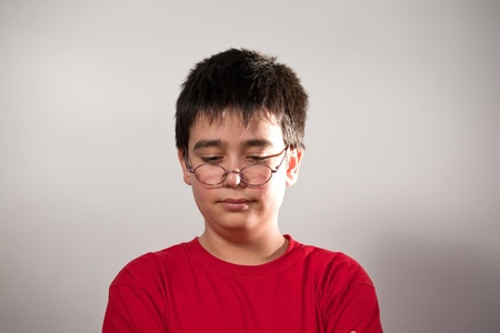 Portrait of a funny young man in spectacles. photo