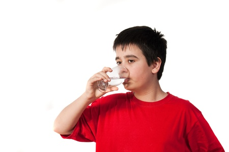boy drink cold water from the glass. Stock Photo - 12957966