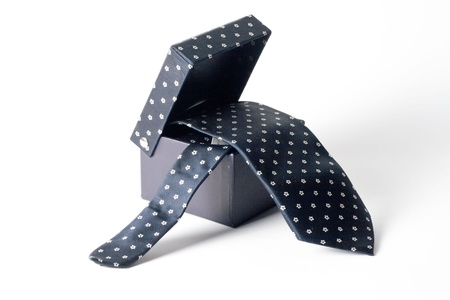 black box from which hangs a tie white background photo